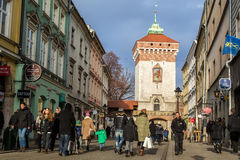 Medieval tower of the Florian Gate at winter in historical part of Krakow. Royalty Free Stock Photos