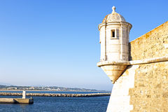 Medieval tower from Fortaleza da Ponta da Bandeira at Lagos Stock Images