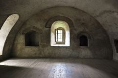 Medieval tower interior. Room in old medieval tower castle at Humor monastery, Romania. Only light is daylight through windows Royalty Free Stock Image