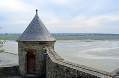 Medieval tower in Mont Saint Michele in France, Normandy. Medieval tower in Mont Saint Michele in Normandy, France. View of the ocean and the meadows stock image