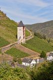 Medieval tower overlooking vineyards and small town in Bacharach, Germany. Vineyards grow up the mountain. royalty free stock photos