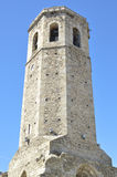 Medieval tower in Puigcerdà with blue sky, Cerdanya, Girona, Spain. Detail of the church of Santa Maria in the town of Puigcerd Royalty Free Stock Photography