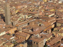 Medieval tower and roofs in Bologna. Medieval tower and red brick roof in the city centre of Bologna (aerial birds' eye view from Asinelli tower Royalty Free Stock Photo