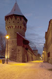 Medieval tower Sibiu winter by dusk. Medieval tower and defense wall in town Sibiu winter snow by dusk Royalty Free Stock Photo