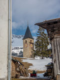 Medieval tower of a village church in the Alps - 3. Medieval bell tower of a small village church in the Swiss Alps - 3 Royalty Free Stock Photos