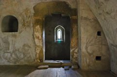 Medieval tower window. Strong daylight shines through tiny window in an old medieval tower at Humor monastery, Romania royalty free stock images