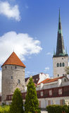 Medieval towers - part of the city wall and St Olaf (Oleviste) Church. Tallinn, Estonia Stock Image