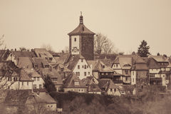 Medieval town beyond the pinion wall. View of the medieval town beyond the pinion wall. Rothenburg, Bavaria, Germany. Retro toned Royalty Free Stock Photography