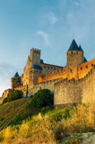Medieval town of Carcassonne at sunset. Fairy castle Stock Images