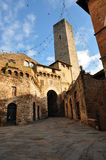 Medieval town on a Christmas day. A partially Sunny day, shot of a medieval-age stone-buildings in an old Italian town, San Giminiani, Tuscany, Italy with Stock Images