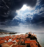 Medieval Town Dramatic Sky. A medieval town with a dramatic storm filled sky Stock Image