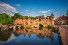 Medieval town gate in Amersfoort, Netherlands. Medieval town wall and gate named Koppelpoort and the Eem river in the historical center of Amersfoort Royalty Free Stock Photos