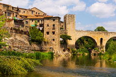 Medieval town with gate on bridge. Besalu Stock Photography