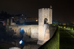 Medieval town with gate on bridge in night.  Besalu Royalty Free Stock Photos