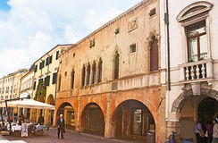 The medieval town. PADUA, ITALY - APRIL 23, 2012: Tourists walk through the medieval streets with preserved villas and mansions, visit cafes and shops, hiding Stock Photography