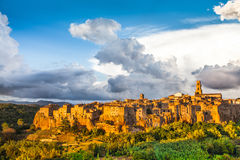Medieval town of Pitigliano with dramatic clouds at sunset, Tuscany, Italy Stock Photo