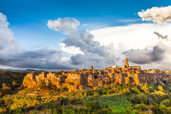 Medieval town of Pitigliano with dramatic cloudscape at sunset, Tuscany Stock Image