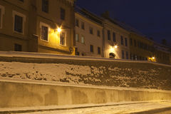 Medieval town Sibiu in winter at night. Medieval town Sibiu in winter defence wall and houses front at night with snow covering the bricks Royalty Free Stock Images