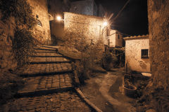 Medieval town street. At night stock photography