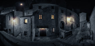 Medieval town street. At rainy night stock image
