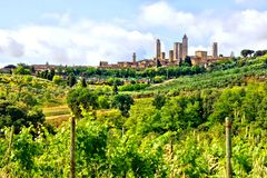 Medieval town and Tuscan countryside. Countryside of Tuscany towards the medieval town of San Gimignano, Italy Stock Photo