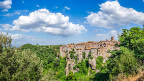 Medieval town of Vitorchiano in Lazio, Italy. Beautiful view of the medieval town of Vitorchiano with stunning cloudscape, province of Viterbo, Lazio, Italy royalty free stock photo