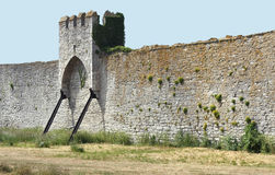 Medieval Town Wall and Tower. Medieval town wall with hangtower royalty free stock photo