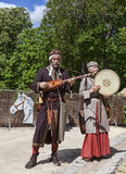 Medieval Troubadours. Nogent le Rotrou,France- May 11, 2013: Two Medieval troubadours playing a traditional song during the Percheval Medieval Festival near the Royalty Free Stock Photo