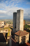 Medieval twin towers. A partially Sunny winter day, shot of two medieval-age stone-towers in an old Italian town, San Giminiani, Tuscany, Italy Stock Photography