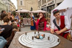 Medieval university. Science and Alchemy, XVI. Moscow, Russia - August 15, 2018: Medieval university. Science and Alchemy, XVI. People at a festival times and royalty free stock photo