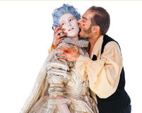 Medieval vampire biting woman Royalty Free Stock Photography