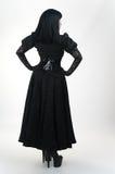 Medieval vampire girl in black red dress stock photo
