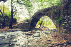 Medieval Venetian bridge in the sun rays. At the spring day. Cyprus bridge Tselefos. Wide angle. Toned image Royalty Free Stock Photography