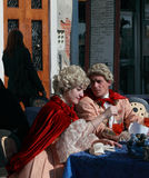 Medieval Venetian couple. Venice,Italy,February 26th 2011:A young couple wearing medieval costumes discussing on a terrace in Venice during the Carnival days.The Stock Image