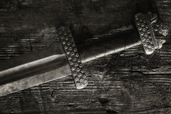 Medieval viking sword against a wooden wall Stock Images