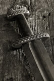 Medieval viking sword against a wooden wall royalty free stock image