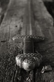 Medieval viking sword against a wooden wall Royalty Free Stock Photos