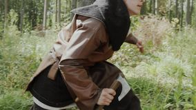 Medieval vikings carry out investigation of the territory in the forest. Beech forest. Medieval Reenactment stock video