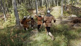 Vikings running in the forest to fight in a battle Royalty Free Stock Image