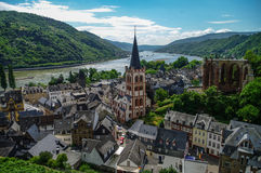 Medieval village Bacharach. City panorama from hill, covered by Stock Images