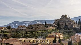 The medieval village of Castiglione d`Orcia against the snow-covered hills, Siena, Tuscany, Italy royalty free stock photos