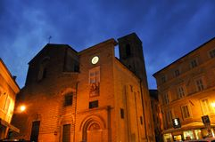 Medieval village of Mogliano in central Italy. Night shot of the church of Santa Maria di Piazza in the medieval village of Mogliano. Marche region, central royalty free stock photos