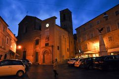 Medieval village of Mogliano in central Italy. Night shot of the church of Santa Maria di Piazza in the medieval village of Mogliano. Marche region, central stock photo