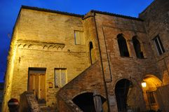 The medieval village of Monte San Martino in central Italy. Night shot of the convent of San Benedettine in the medieval village of Monte San Martino. Marche stock image