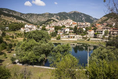 Medieval village near mountain lake Royalty Free Stock Image