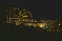 Medieval village at night under stars Royalty Free Stock Photo