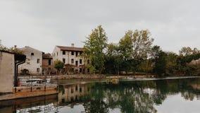 Medieval village river in Italy. Medieval village near lake Garda. Borghetto near Valeggio sul Mincio Royalty Free Stock Image