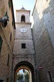 Medieval village of Staffolo in central Italy. Entrance tower in the historic center of the medieval village of Staffolo and bell tower of the Church of San stock images