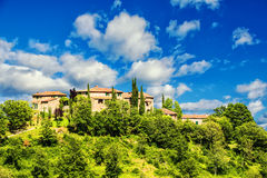 Medieval village in Tuscany (Italy). The typical medieval Tuscan village with its long history perfectly maintained and renovated Royalty Free Stock Image