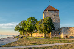 Medieval Visby in Sweden. Visby, Sweden – June 10, 2014: The medieval city wall and the Gunpowder Tower at sunset. Visby with its famous city wall from the Royalty Free Stock Images